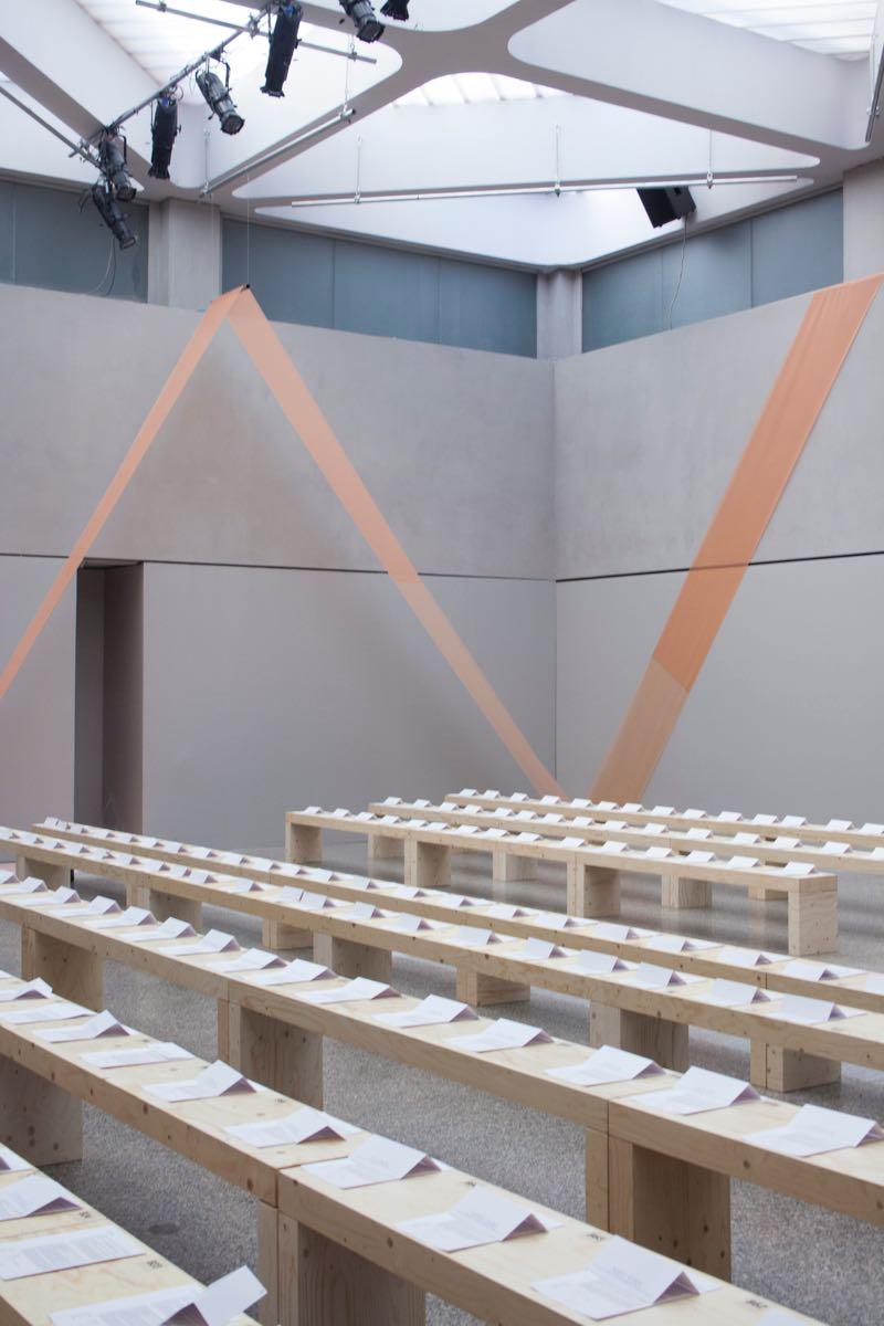 Simple pine slab benches await an audience at the Sportmax Spring / Summer 2016 show.