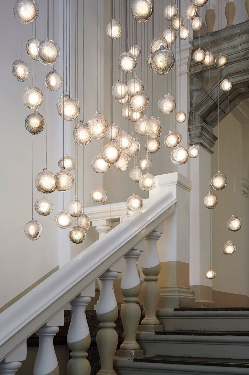 A multitude of the new '76' lights cascading down the grand staircase at Bocci Berlin.