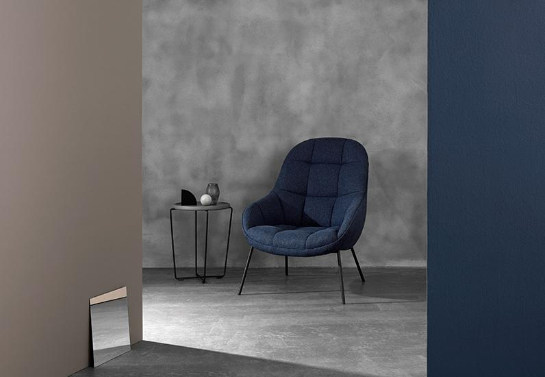 The 'Mango' armchair by Note Design Studio for Won Design. Smooth exterior sectional padded interior. The side table is called 'Cage' and is by Spark Design Studio from the Won Design collection.