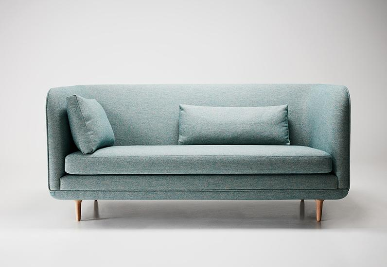 The 'Room' sofa is a compact two-seater sofa by 365º North with high arms and back for extra cosiness. The legs are turned in a subtle trumpet shape and piping runs neatly around the form like a frame.