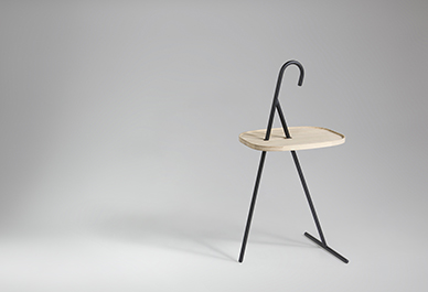 The 'Handy' side table by Singapore-based designer Nathan Yong for Won Design, features an umbrella style handle and solid oak top. The frame is available in white or black painted steel.