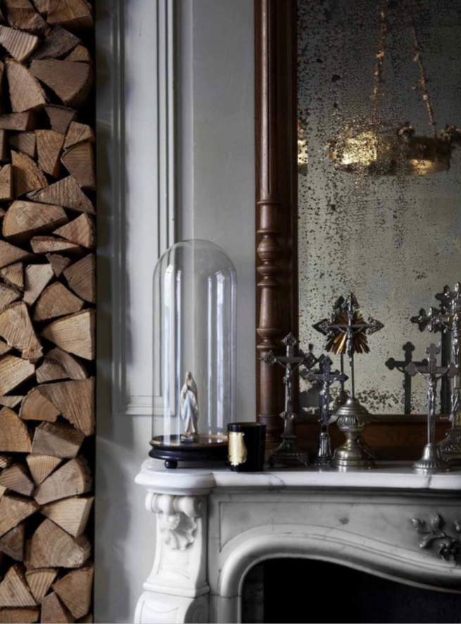 Aged mirrors and vintage cloches are scattered about the Boulevard Leopold, as are a huge number and variety of crosses. The house built in 1870, retains many of its original features including incredible marquetry floors and a ground floor ceiling height of 4 metres. Photography by Sharyn Cairns.