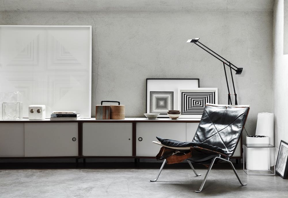 The interior of Bea Mombaers' house in Knokke in Belgium combines design objects showing obvious signs of age with pale walls and polished concrete floors. Texture and patina form the backdrop for the curated works on display.