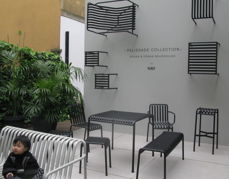 The Bouroullec's 'Palissade' collection on show (and cool baby) at Pelota in via Palermo in the Brera district.