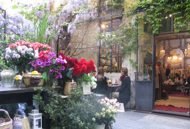 The courtyard of fashion store Antonio Marras in Tortona, resplendent with florist and a pop up restaurant.