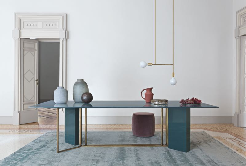 The 'Plinto' table by Andrea Parisio for Meridiani. The styling brings brass, grey blue lacquer and soft plum velvet together.