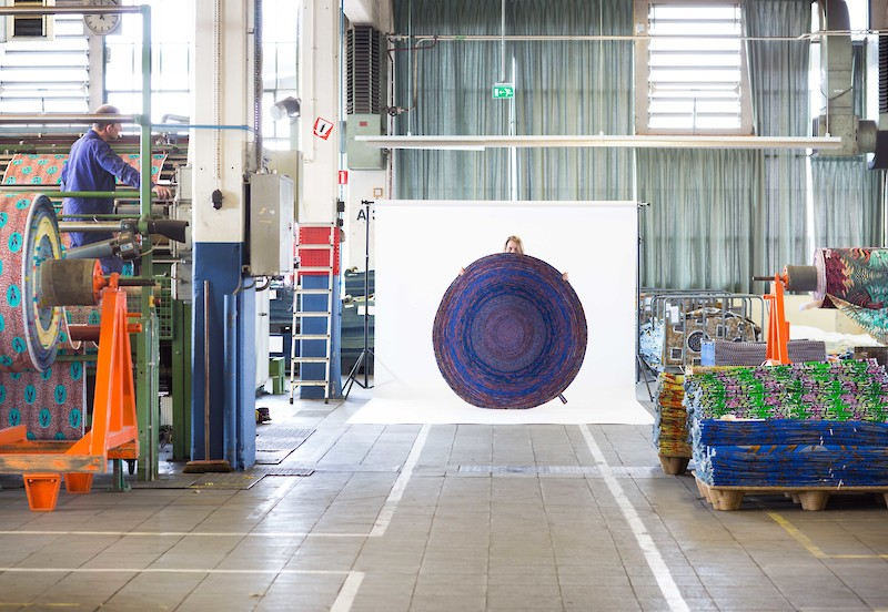 The Vlisco fabric factory in the Netherlands and Simone Post's 'Carpet Vlisco Recycled'.