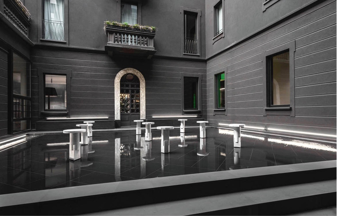 OEUFFICE 'Kapital' collection of white marble tables for Carwan Gallery - on show in the courtyard of the Senato hotel.