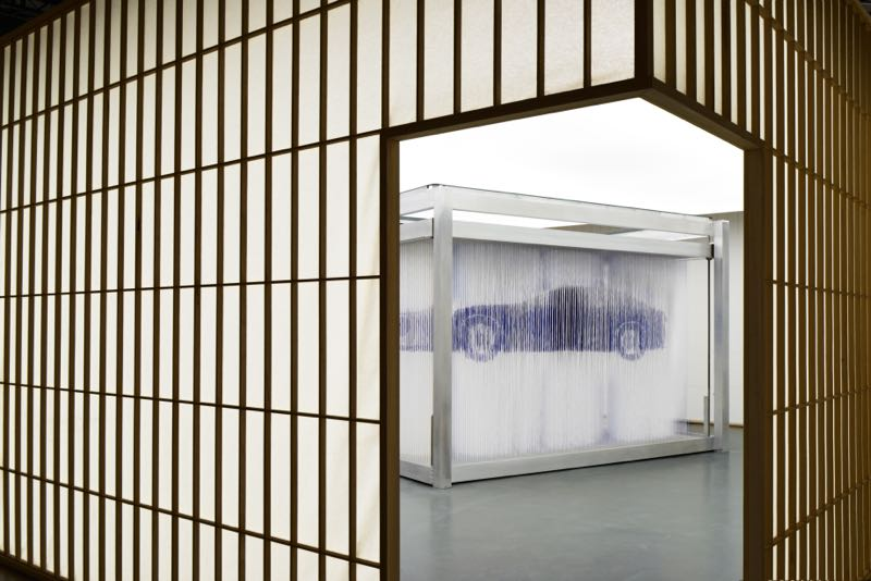 Formafantasma's presentation of the Lexus concept car involved thousands of white strands that rose to reveal the look of the car, then collapsed to nothing to start the process all over again. Shoji-style walls created a strong Japanese aesthetic.