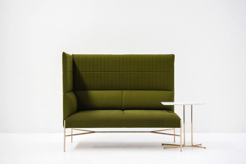 Tacchini added a high backed sofa to Gordon Guillaumier's existing 'Chill Out' collection and launched the new 'Ledge' side table, also by Guillaumier.