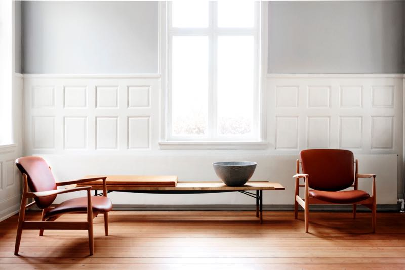 Finn Juhl's 'France' chair (originally manufactured by France & Sons as the FJ 136 in 1956 ) is back in production with Denmark's One Collection (shown here with a Finn Juhl bench).