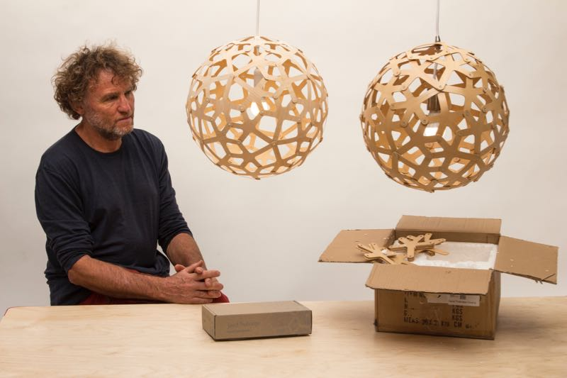 David Trubridge with his well known 'Coral' light. The original (left) and a replica (right). Note the difference in packaging!