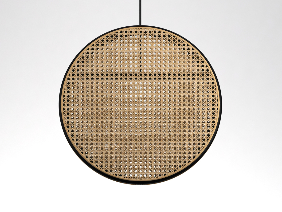 The 'Jacaranda' pendant light by Dennis Abalos. The frame is in steam bent rattan, the other surfaces in woven cane.