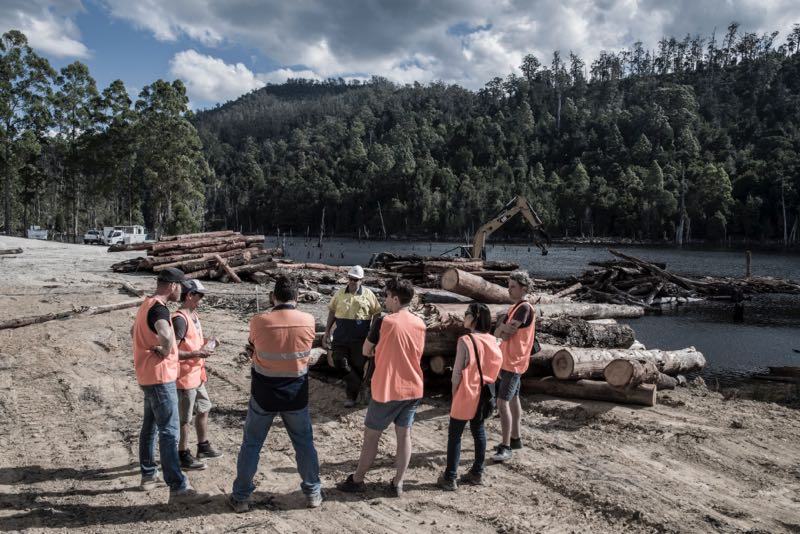 The designers and MIchele Chow of Dessein learn about the origins and processors of the Lake Pieman timbers from Hydrowood staff. Photo: Chris Crerar.