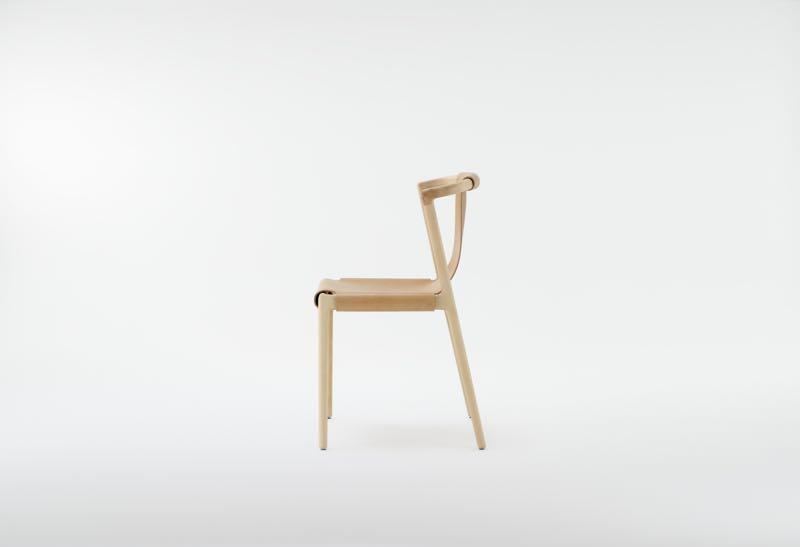 Side view of Tom Fereday's 'Pieman' chair for Dessein. The leather sling is removable and held in place by press studs.