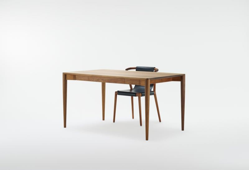 Tom Fereday's 'Pieman' chair in black leather behind the 'Pieman' desk by Nathan Day. Both are in Tasmanian Blackwood.