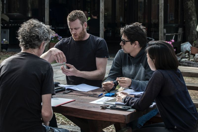 Simon Ancher talks through the finer points of his shelving design with Marcus Piper (left), Nathan Day & Michele Chow (right). Photo: Chris Crerar.