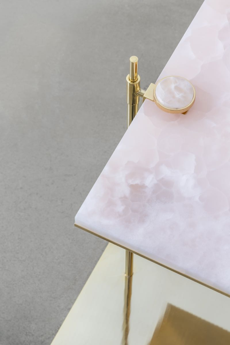 Close-up of Formafantasma's 'Domus' side table showing the beauty of the pink Onyx stone.
