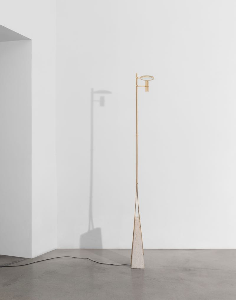 'Magnifier' - a floor lamp in gilded brass with travertine base, glass magnifier and LED light source.