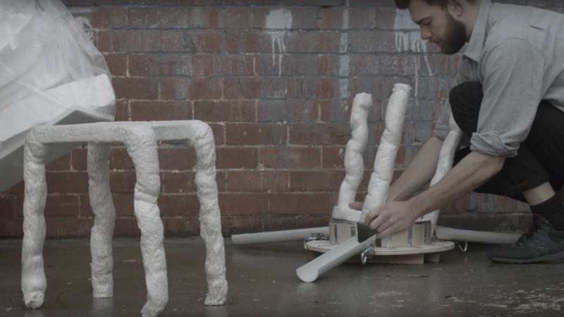 Peter Trimble's 'A Rubbish Stool' in the process of being removed from the mould. A still from the film by Lucy Foster.