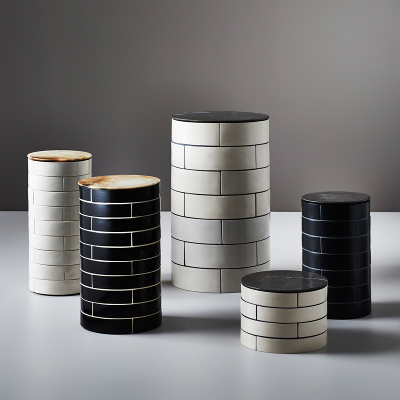 A grouping of 'Metro' side tables including (L to R) 'Slender, 'Burly' and 'Butch'. The grout can be specified to contrast or match to create different effects. The stone variety can be specified.
