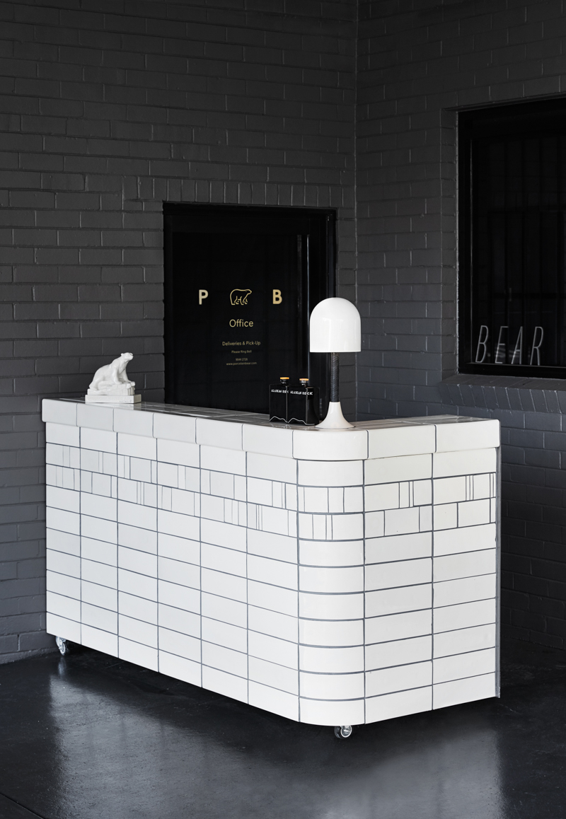 An example of the application of the Metro tiles on custom furniture pieces. Shown here is a bar area within the Porcelain Bear showroom.