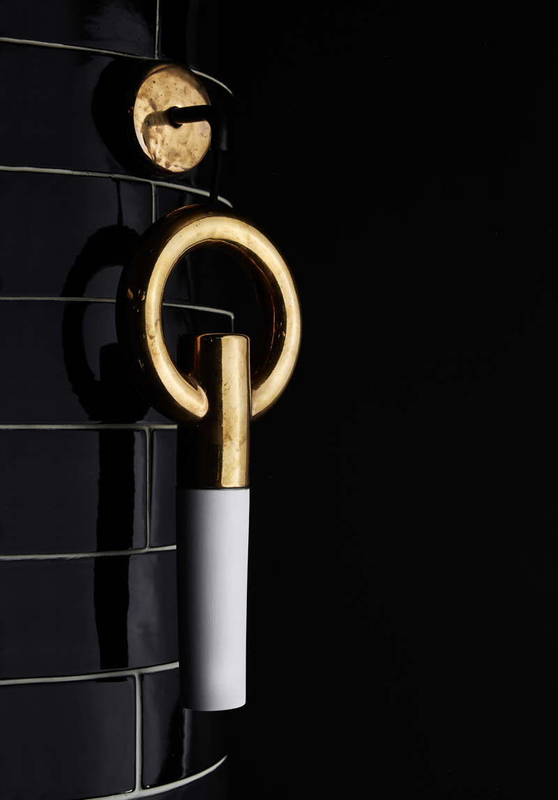 A 24-carat gold glazed version of the 'I-O-N Wall O' wall lamp by Porcelain Bear.