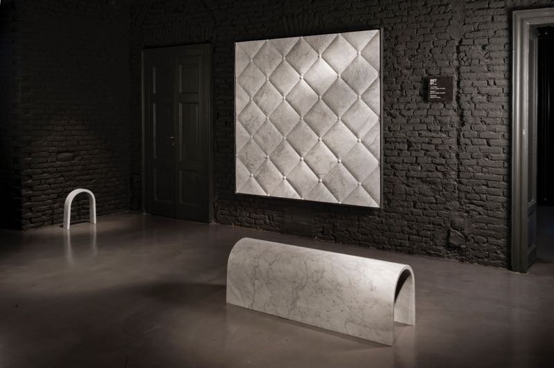 Pieces from Ron Gilad's Soft Marble installation in Salvatori's Milan showroom, including the Galleria bench and  'Cuscina' tile.