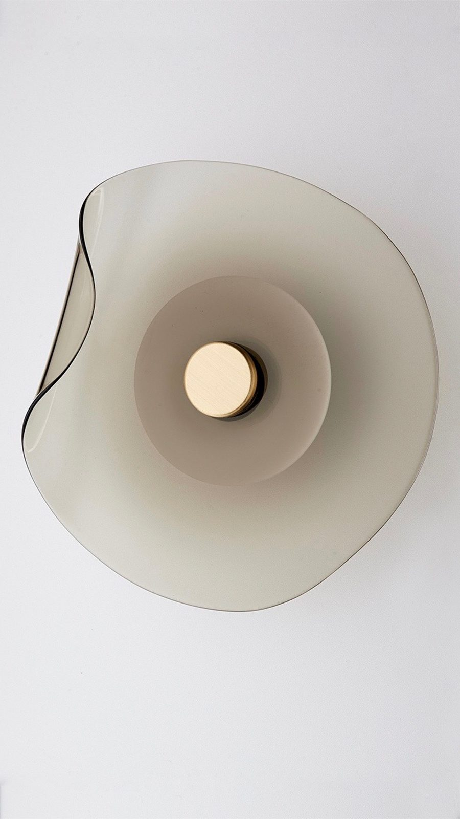 'Melt' wall sconce in 'smoke' from Articolo Architectural Lighting.