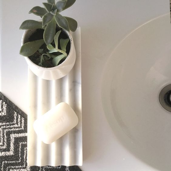 'Chevron Tray', and 'Round tray' by Evie Group.