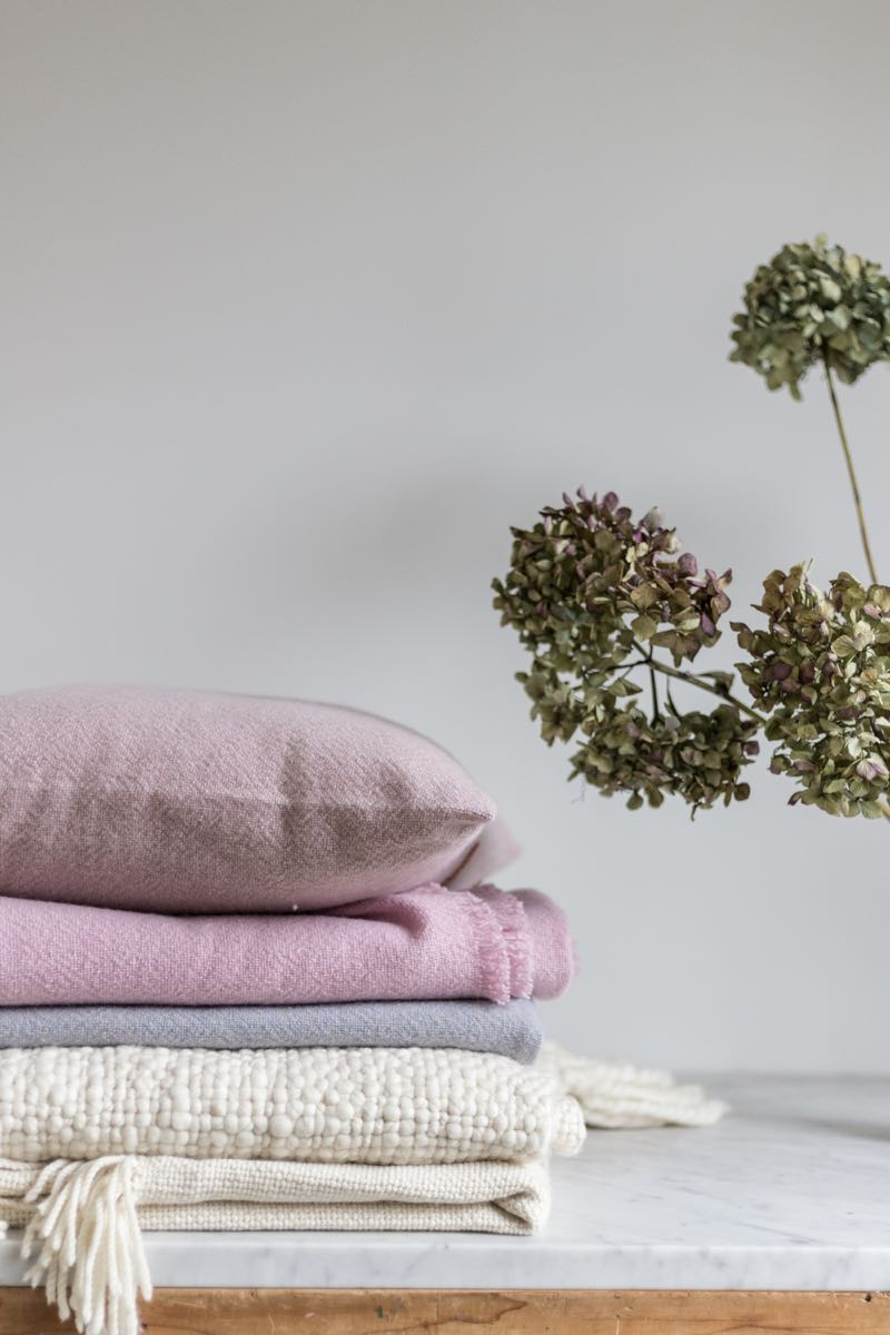 The Fisherman's throw (bottom) and other hand-woven fine wool throws and cushions by Karina Pires for House of Six.