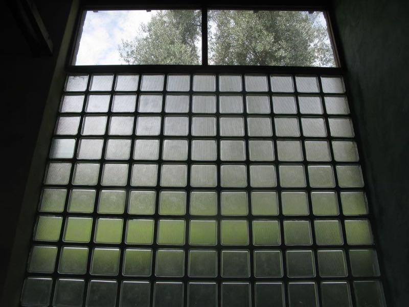 A wall of glass bricks showing the beautiful metal framework.