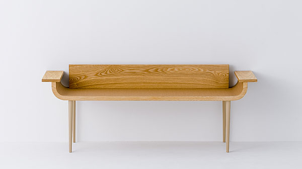 Bench with arms by José Lévy. The seat is made from tatami mat.
