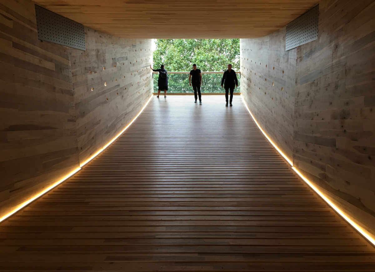 The Smile's wooden tunnel and gently climbing floor leads to giant openings at both ends.