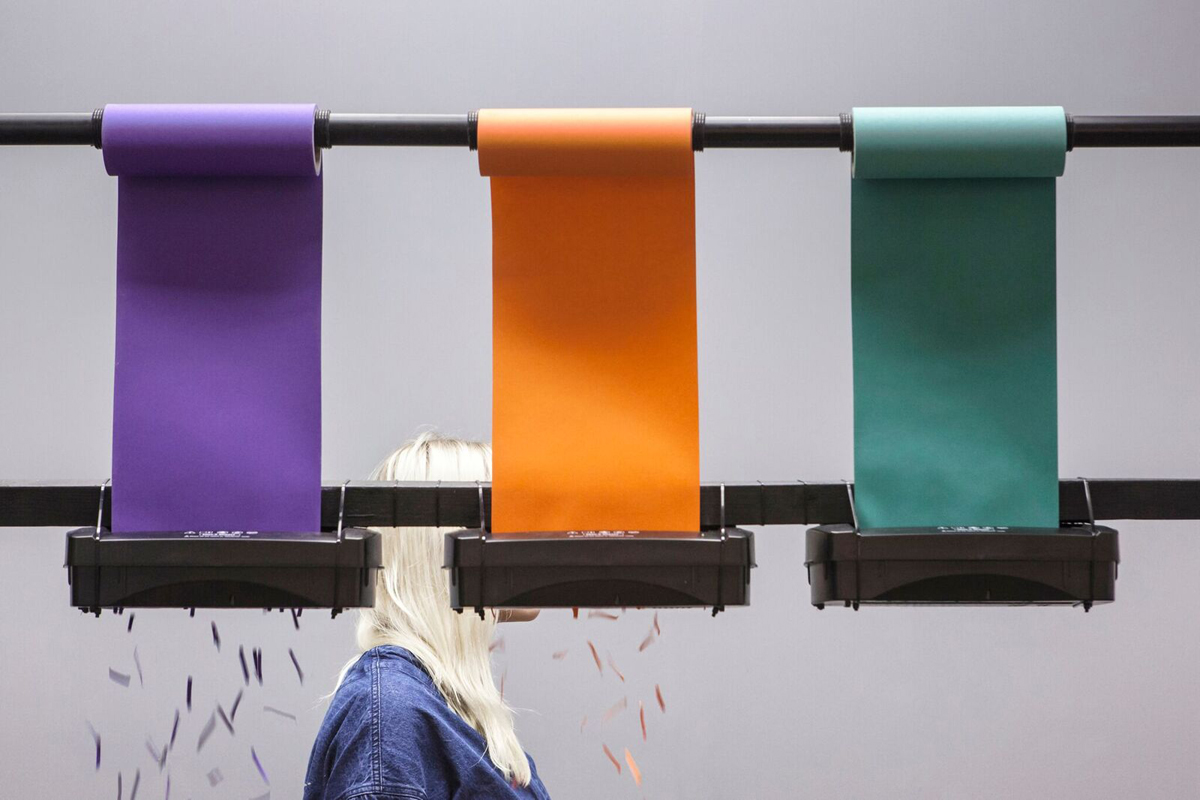 Raw Colour's  Chromatology -  a row of shredders hard at work at  Blend held at Aram Gallery.