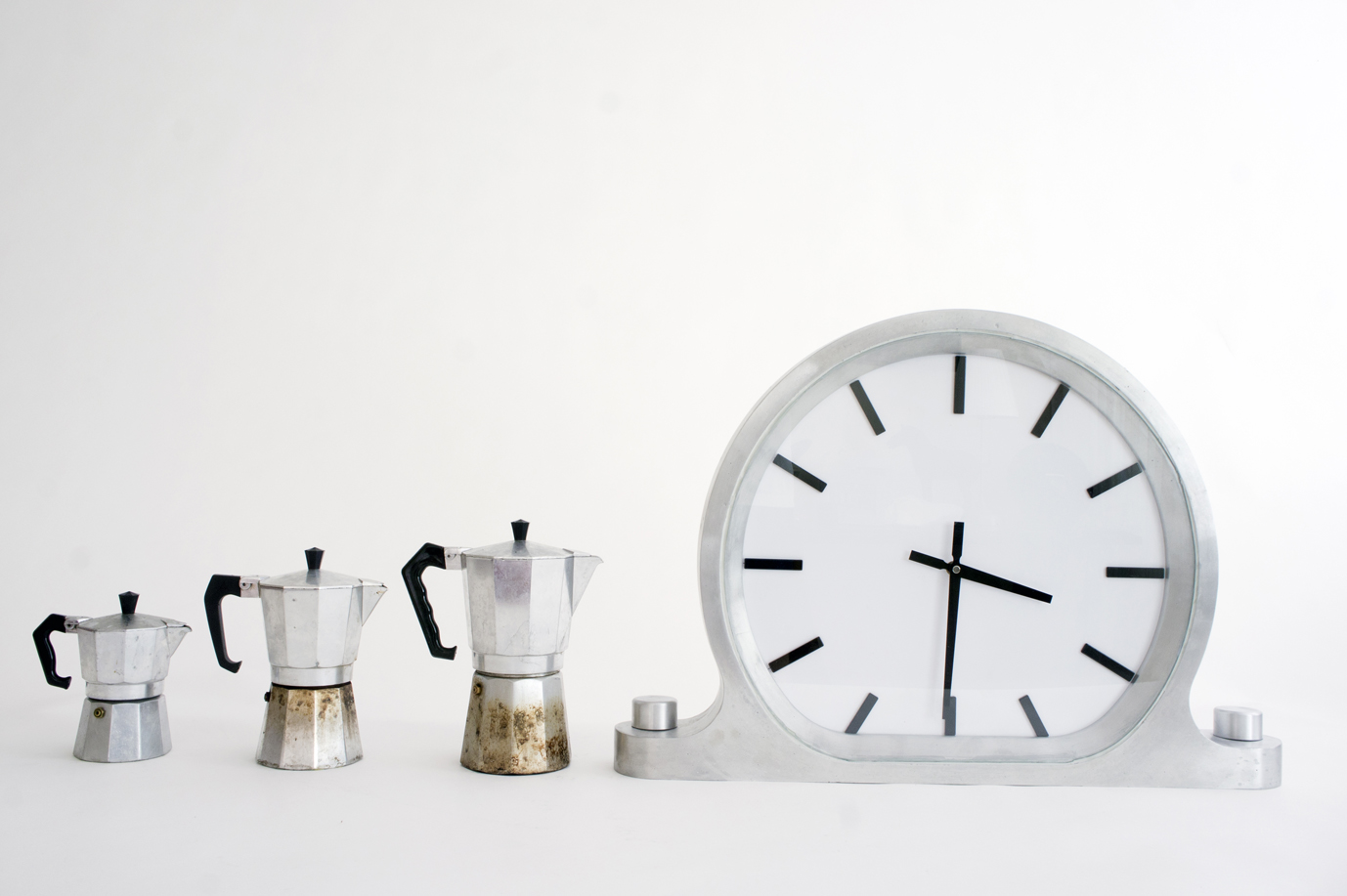 Glen Baghurst's 'Wall clock'  takes simplicity and monumentality to a new level. The coffee pots are to give some sense of scale and are not a reflection of Baghurst's obsession with coffee (yeah right).