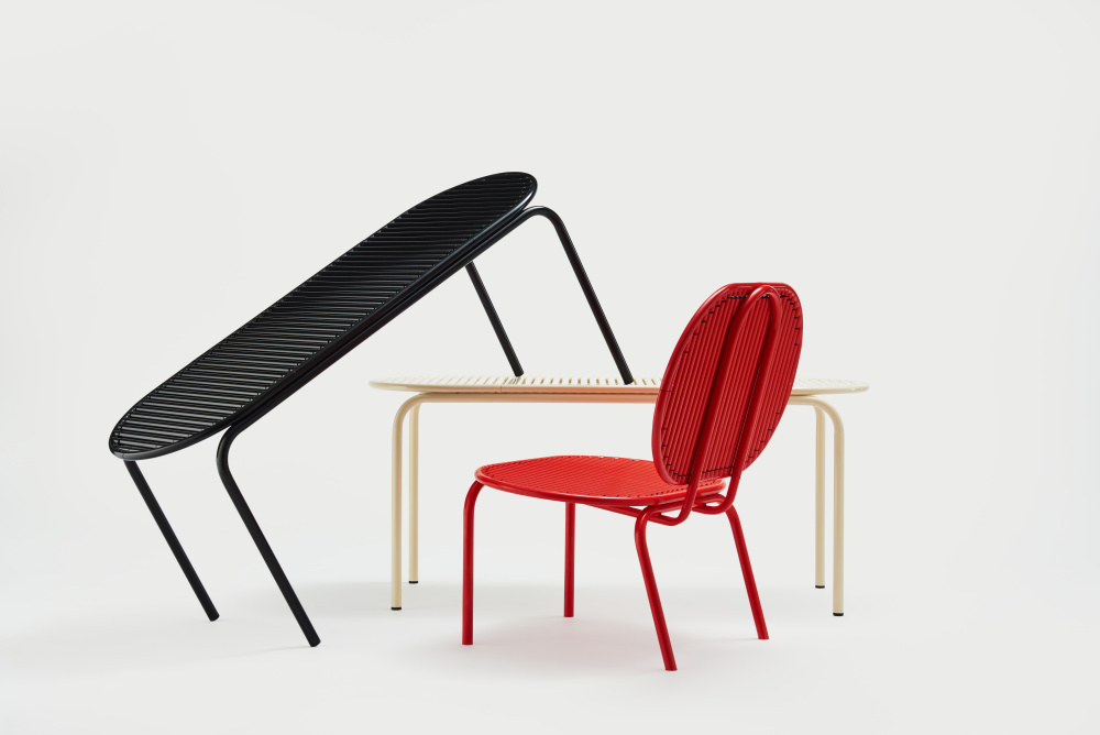The 'Roll' collection  designed by    Verena Hennig ,  formed the furniture for Design Junction's VIP area. The 'Roll' collection  features revolving rods of aluminium that on the chair help to encourage blood circulation which improves long-term comfort.