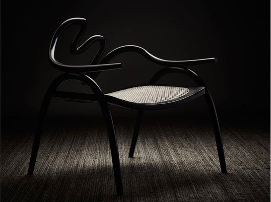 A chair from Studio Swine's  Fordlandia  exhibition made from a hard rubber called Ebonite. Photograph by Petr Krejci.