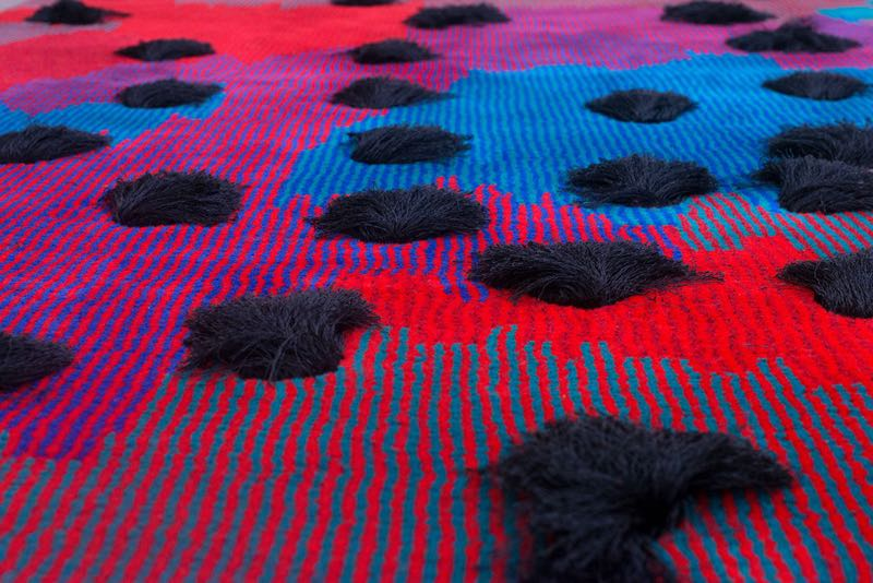 The 'Frequencies' rug by Studio Truly Truly was e xhibited at   Particles & Frequencies  at Dutch design Week in 2014. The  merino wool is accentuated by 'mega-tufts' of polyester  offering in an abstraction of energy waves &microscopic particles.