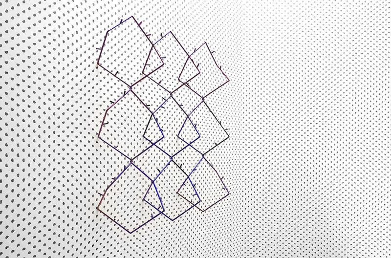 A scene from Studio Truly Truly's  Frequencies & Particles  exhibition showing their 'Particles' wallpaper for NLXL &'Seismic' wall sculpture.