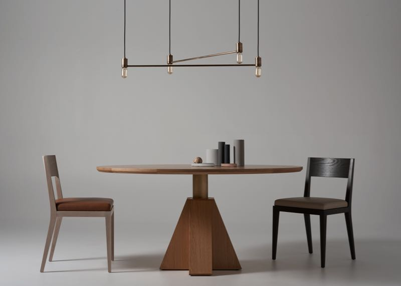 M-table in oak with brass column and M-chairs in limed oak (left) &back stained oak (right). The light above is the 'Constellation' by Sydney design studio Anaesthetic.Photo by Kelly Geddes.