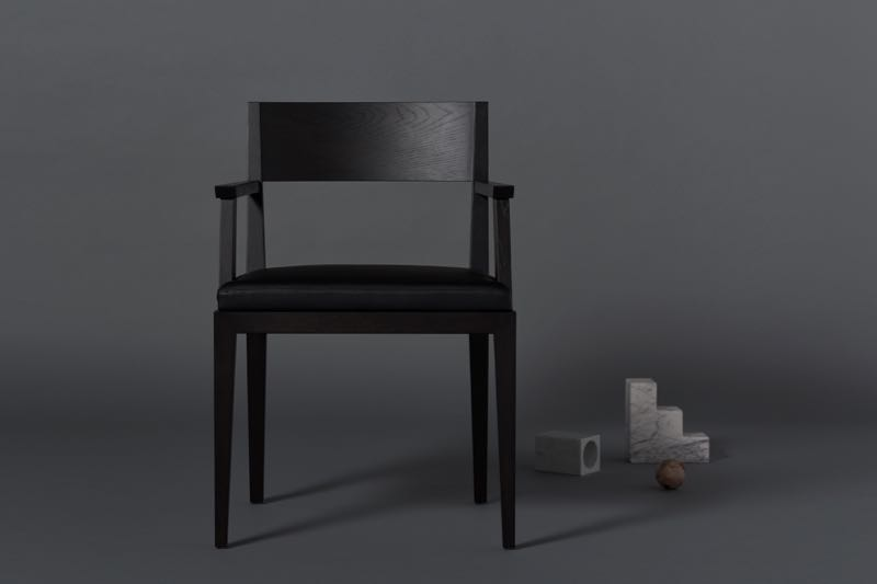M-chair in black stained oak with marble and petrified wood objects.
