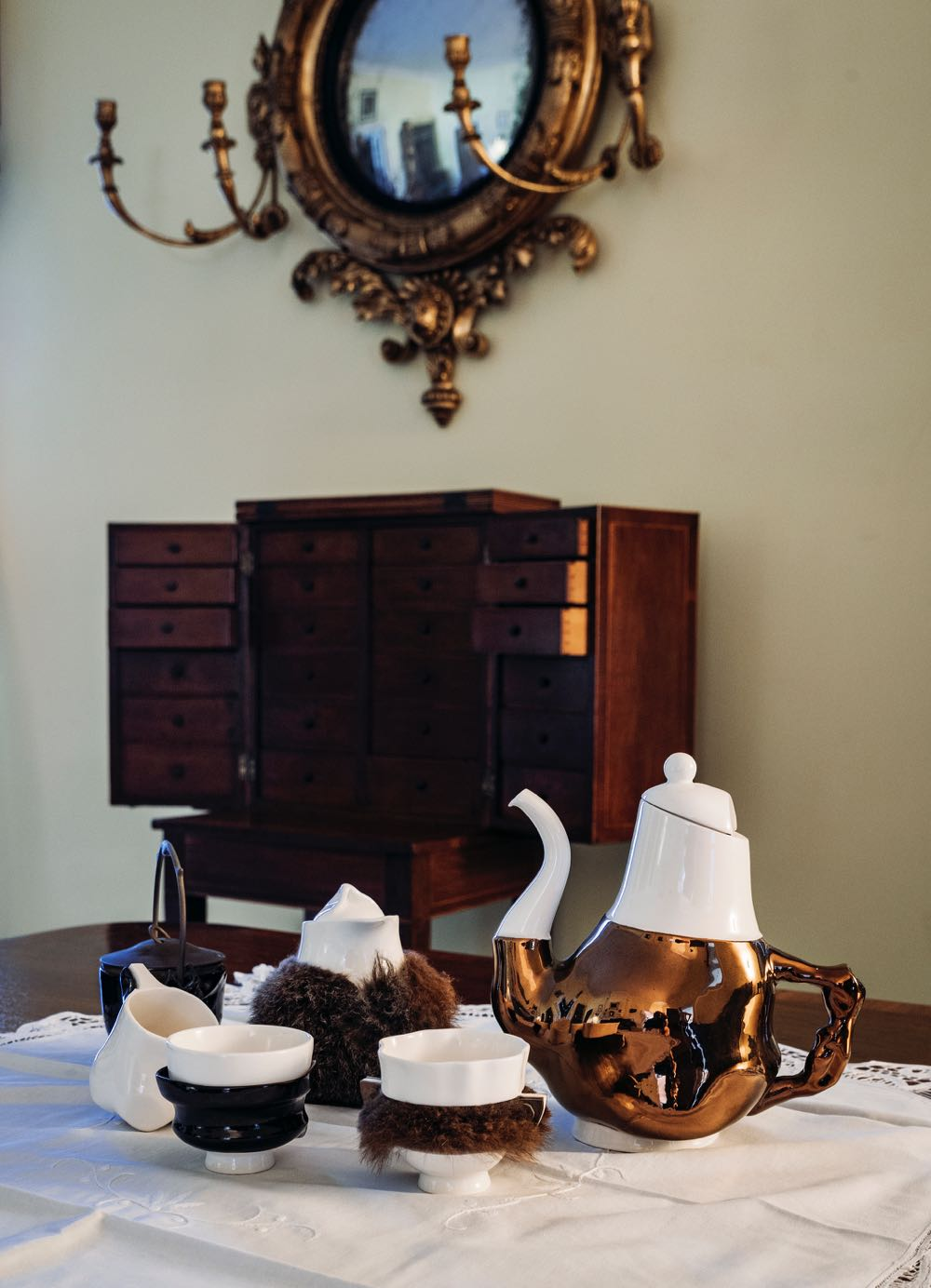 Trent Jansen's 'Briggs Family Tea Service' for Broached Commissions (2011) in slip-cast porcelain, wallaby fur, bull kelp, copper and brass.