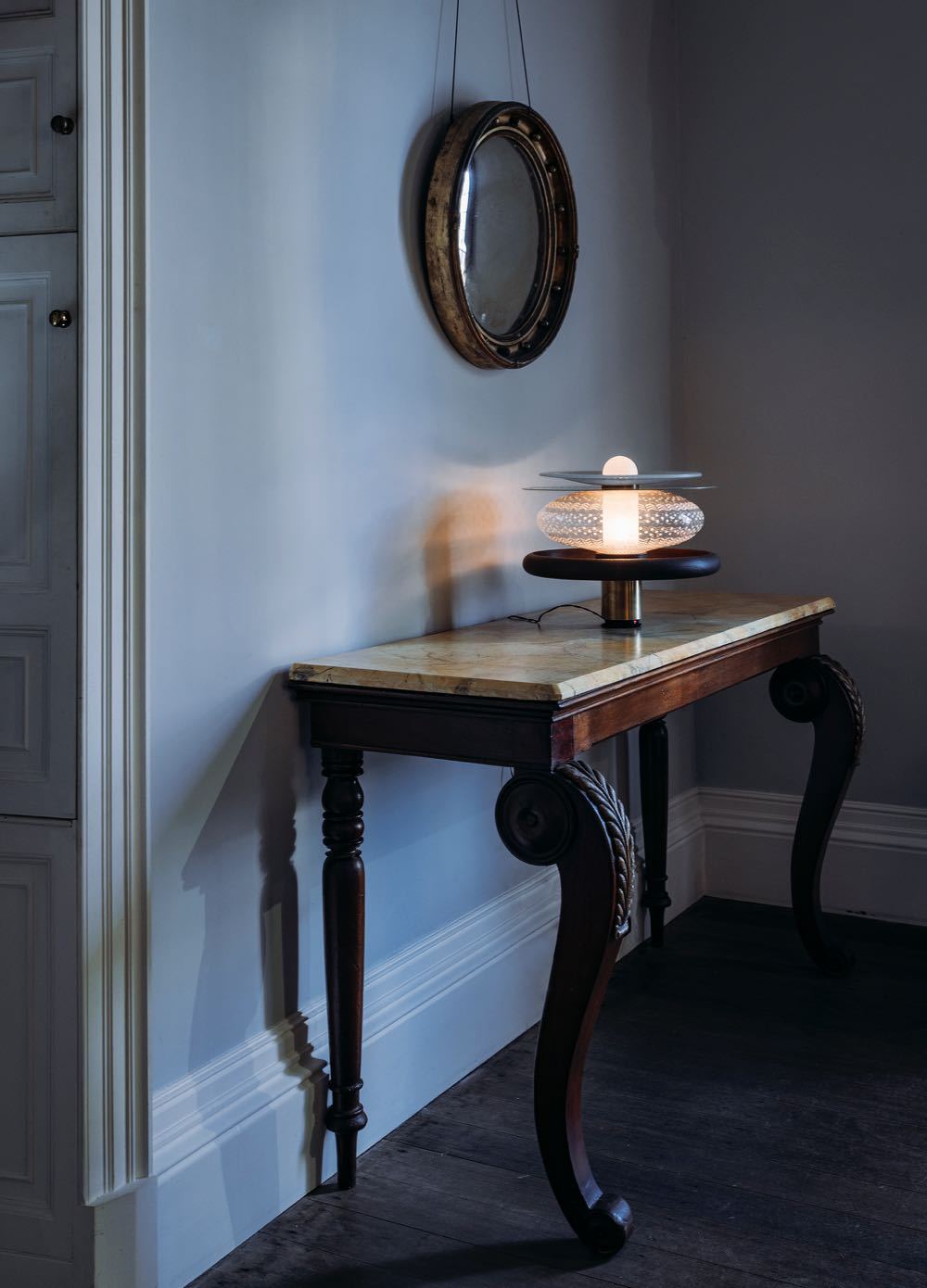 Chen Lu's Dream Lantern table lamp sitting atop a console from the Old Government House collection.