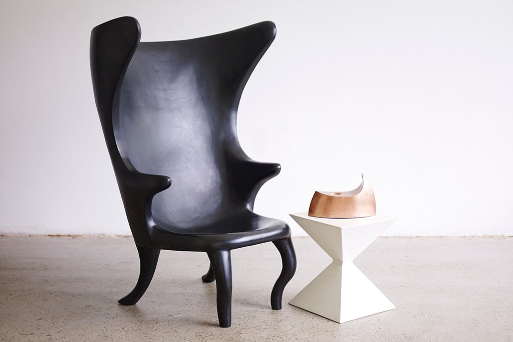 Sarah K's 'Wingback  Carbon chair' is a limited edition of 5 designed around the traditional Danish Wingback form. The chair is hand carved carbon fibre and takes a completely different tack than most products in this material.