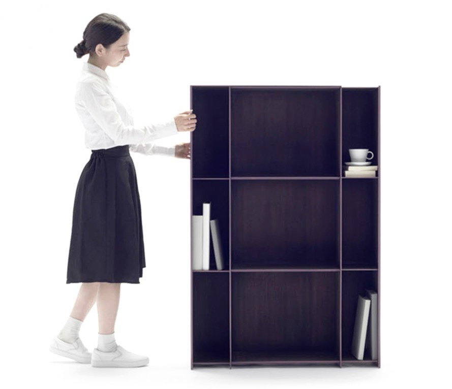 Nendo's 'Nest' shelving from 2015 - an expanding shelving unit made from lightweight carbon fibre. The unit can be compressed or expanded at will simply by pushing or pulling the side wall.