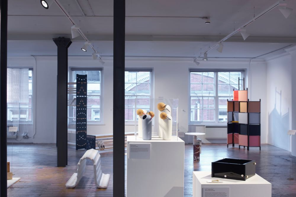 The exhibition featuring works by Tomas Kral (centre) Rive Roshan (far right) and Adam Guy Blencowe (far left). The white bench on the floor to the left is is by Studio Ilio. Photography by Sylvain Deleu.