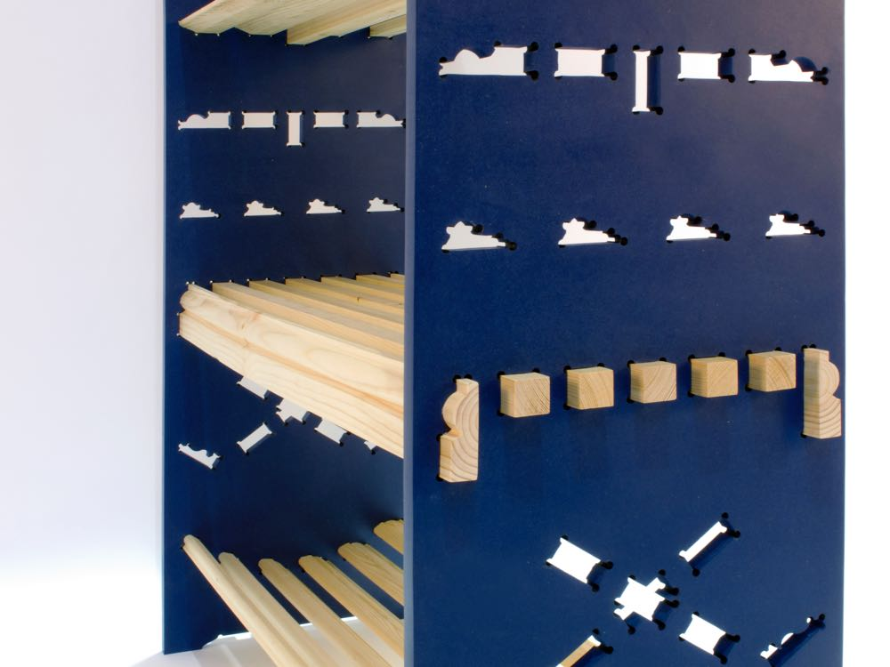 A close-up of Adam Guy Blencowe's 'Dado' shelving revealing the pine dado rails and cut out slots.
