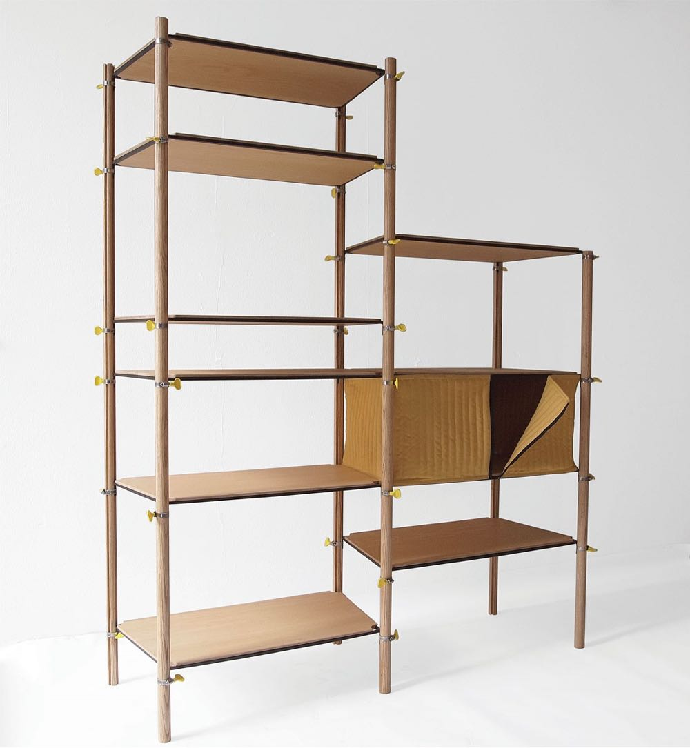 Max Frommeld's 'Hose Clip' shelf (2011). The uprights and shelves are held in place with metal hose clips that tight by a simple thumb screw. Hose clips of this type are widely used in plumbing and automotive applications to join pipes together.
