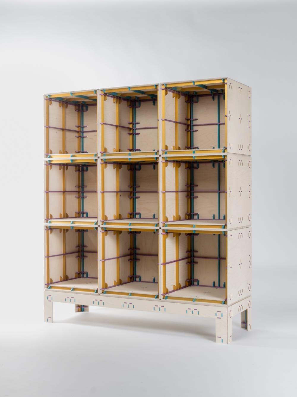 The 'Wrong Colour Furniture System' by Minale Maeda (2013) is made from laser cut sheets of plywood joined by anodised aluminium components that not only allow the material cladding material to come together but also provides bracing.